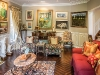 An assortment of sculptures dot his eclectic living room, as well as art pieces by Miller Brittain (left) and Fred Ross (centre)