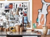 The Perspex desk is a mid-century modern classic and serves as Laureen's work space. Her mood-board and collection of framed art-gallery posters, bought on her travels, completes the academic effect