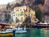 Conca dei Marini's postcard-like harbour is lined with local boats.