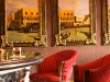 Addison Mizner-inspired entrance; ultra-luxe, intimate lobby bar.