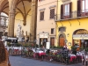 Florence's stunning piazza is surrounded by classic architecture, perfect for outdoor dining.