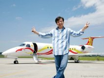 Jackie Chan, Embraer's brand ambassador, stands proudly in front of his Legacy 650.