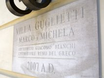 Honouring family and heritage, a plaque welcomes guests to the Guglietti villa in Vaughan. Architect Giacomo Bianchi designed the home's courtyard.