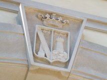 The design for the Guglietti's hand-carved, limestone crest was the result of archival research in Italy.
