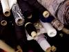 Spools of fabric embellish the backroom of Matis's spacious studio