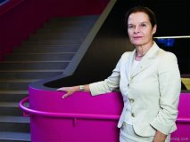 Marianne McKenna stands by the hot pink staircase she conceived for the Rotman School of Management