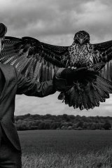 model in suit with bird