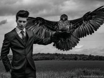 model in suit with bird