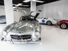 Miami Supercar Rooms' dining experience allows guests to purchase a pod, where they can enjoy a custom five-course meal prepared by a local chef next to classic vehicles, such as a 1955 Mercedes-Benz 300 SL Gullwing and a 1958 Maserati 450 S vintage racing car (right). Each pod also comes with an associate who can answer any questions guests have about the car