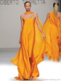 ▲ This Roberto Torretta gown sets fire to summer style with a delicious silhouette dipped in vibrant orange.  www.robertotorretta.com
