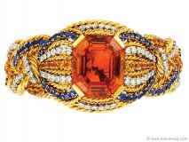 ◀ All that glitters is gold — and citrine, sapphire and diamond. This 1960s treasure will kick a hint of retro into any jewelry box.  www.simonteakle.com