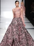 ▶ Lovely as a hand-picked bouquet, this gown's antique feel and regal silhouette transport the wearer to a royal garden.