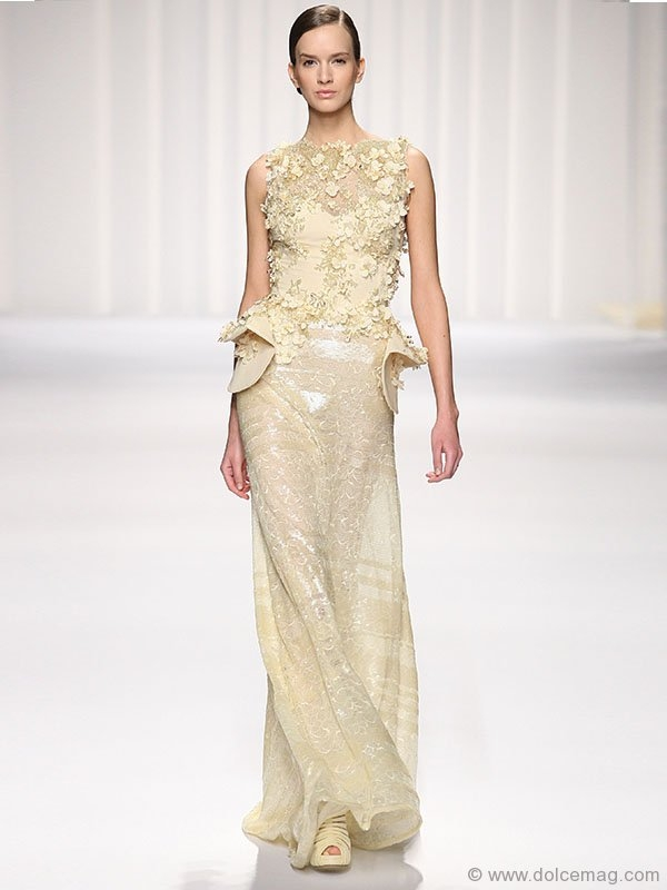 ▶ An angelic hue, a creamy texture and a touch of shimmer — this radiant gown is the stuff dreams are made of.