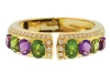 ▲ Juicy gems sparkle against 18-karat gold to create a bangle worthy of both formal events and everyday wear.  www.jsfearnley.com
