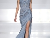 ◀ Staying true to 2013's frilly trend, this gown showers femininity with  its floral accents and  eye-catching cutouts.