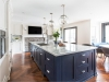 This bold and beautiful blue island holds centre stage in this stunning hand-painted face-framed transitional kitchen. Designed by Aim Interior Design. Fabricated and installed by NIICO | Photos by Vanessa Galle