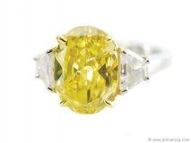 3.69 carat vivid yellow oval diamond