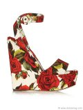 Set off that cute red number you've been waiting to wear all winter with these Dolce & Gabbana floral-brocade wedge sandals. The brilliant roses tell the world that you've left the cold behind. www.net-a-porter.com
