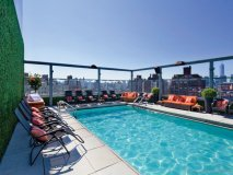 """DIAL 1 FOR BIKINI: Gansevoort Meatpacking NYC took bikini season to the next level this year with its """"bikini concierge."""" Sans Sucre Swimwear experts will come to guests' hotel rooms to help them find their perfect suit 