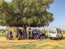 mobile health clinic in eastern chad where the community knows msf provides ongoing medical care under this specific tree