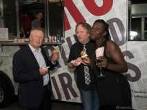 Left to Right: Bryan Snelson VP RBC Securities, Brad Barker (Radio Host), Garvia Bailey (Radio Host) enjoying food from the HERO burger food truck at the 2015 Panama Jazz Connection on July 23