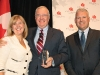 Canadian Club of Toronto president Jennifer Sloan, Martin with his 2014 Lifetime Achievement Award and Canadian Club of Toronto vice-president Fred Mifflin. Photo by Mike Hagarty