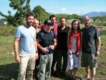 Paul Haggis and APJ board members Gerard Butler, Ben Stiller, Olivia Wilde and supporters walk the land in Haiti that was just purchased for  the Academy for Peace and Justice