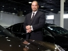 Shaun Jalili stands amongst his dealership's collection of rare and luxurious vehicles. As president of Platinum Cars, he holds an innate understanding of top-notch service and luxury automotives