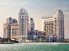 The extravagant St. Regis Doha Hotel is surrounded by the Arabian Gulf