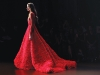 The collection's crescendo is this textured crimson gown. The heated drama of the hue finds harmony with a simplistic silhouette, igniting the imagination