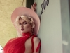 Look 3: Accessories can make or break an outfit; the complementary colour of this hat accents the red dress while adding a vintage touch / Dress: Morphine, Hat: Gladys Tamez Millinery, Gloves: Elisabetta Franchi   Photos by Thomas Louvagny