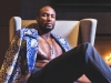 Ibaka poses at the 1500 penthouse suite at One King West Hotel & Residence in Toronto | Jacket - Hendrixroe, Necklace - Finch Centre Jewellers, Belt - Frank and Oak, Trousers - Joao Paulo Guedes, Shoes - Parc City Boots, / Photos by Geoff Fitzgerald