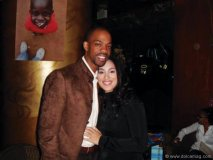 Ashley Walker and fiancé Rafer Alston stand in loving embrace.