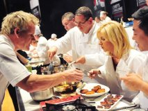 Ramsay meticulously samples the various entrées prepared by each team.