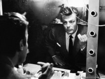 Marcello Mastroianni checks himself in the mirror on the set of La Dolce Vita. Photo By Auturo Zavattini