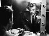 Marcello Mastroianni checks himself in the mirror on the set of La Dolce Vita. Photo By Auturo Zavattini