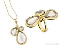 Jewelry house H. Stern reconnects with American fashion designer Diane von Furstenberg to produce a graceful line of chic jewelry. Shining gold bands clasp water-drop shaped jewels, providing complementing centrepieces for elegant evening wear.
