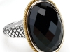 "Beautiful ""Ibiza"" black onyx ring encircled by 18-karat gold and silver band from Birks. Enjoy this gemstone for its mysterious and captivating qualities."