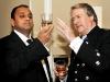 Mahesh Patel analyses the colour of fine whisky next to master blender Richard Paterson.