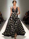Spoil yourself with confidence in this black and silver organza gown.