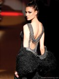"""With a daringly low back and intricate beading, this sultry number screams smoky seductress. Try it on for a new take on the classic """"little black dress."""" ww.sarlicouture.it"""