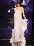 With layers of flowing fabric, this soft pink gown is fit for a Grecian goddess. The dress features a hint of beading along its length, hidden beneath a  sheer overlay.  www.abedmahfouz.com