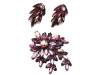 For a hint of glimmer, accessorize with this eye-catching pin, made with fuchsia stones and undulating glass beads. www.caroletanenbaum.com