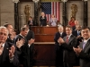 Members of Congress, the Cabinet, and Supreme Court applaud as President Barack Obama enters the House Chamber to deliver his State of the Union address to a joint session of Congress, Jan. 27, 2010.