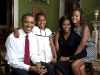 President Barack Obama, First Lady Michelle Obama, and their daughters, Malia and Sasha, sit for a  family portrait in the Green Room of the White House, Sept. 1, 2009.