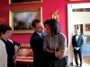 President Barack Obama hugs First Lady Michelle Obama  in the Red Room while Senior Advisor Valerie Jarrett smiles prior to the National Newspaper Publishers Association (NNPA) reception 3/20/09.