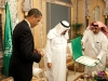 President Barack Obama looks at the King Abdul Aziz Order of Merit presented to him by Saudi King Abdullah bin Abdul Aziz at the start of their bilateral meeting at the King\'s Farm in Riyadh, Saudi Arabia, June 3, 2009.