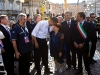 President Barack Obama greets bystanders, as he tours earthquake damage in L\'Aquila with Prime Minister Silvio Berlusconi while attending the G-8 summit in L\'Aquila, Italy, July 8, 2009.