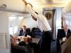 President Barack Obama talks with White House Chief of Staff Rahm Emanuel and Senior Advisor David Axelrod, Senior Advisor during the flight to Caen, France June 6, 2009.