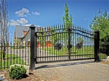 Artistic iron gates encase the charm and exquisiteness of The Castle on the Lake.
